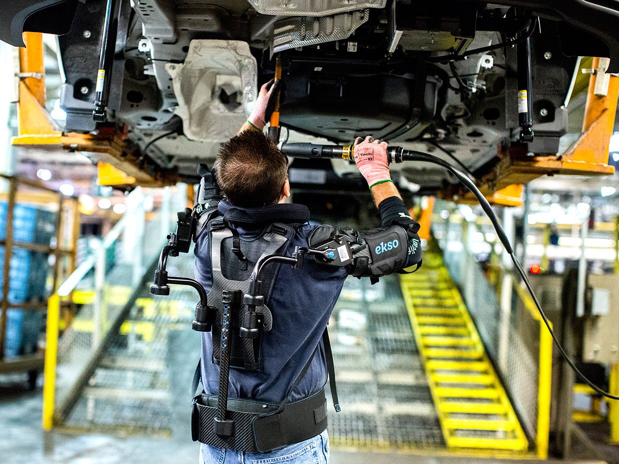 A Ford operator uses an upper arm exoskeleton.