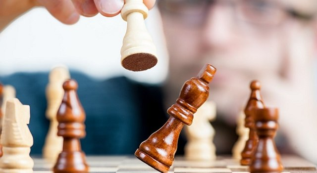 Person making a move in chess