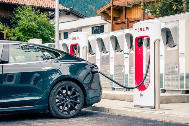 A car charging at Tesla charging station