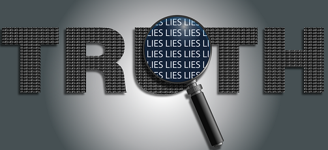 The word truth in capital letters and the word lies under a magnifying glass