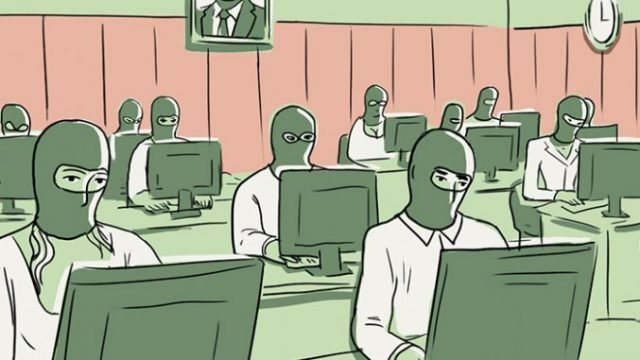 People with masks using computers