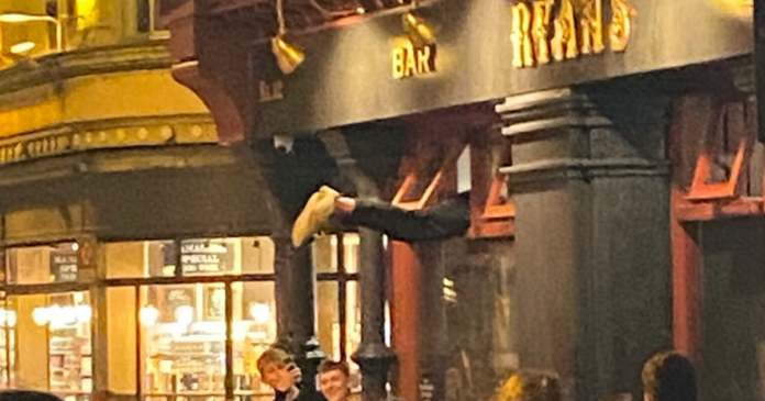 0 lad climbing in through the window of ryans of camden street.png